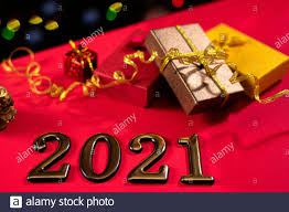 Beautiful New Year's photo with figures 2021 and gifts with ribbons with a  side in the background. Year of the bull, layout, magic card Stock Photo -  Alamy
